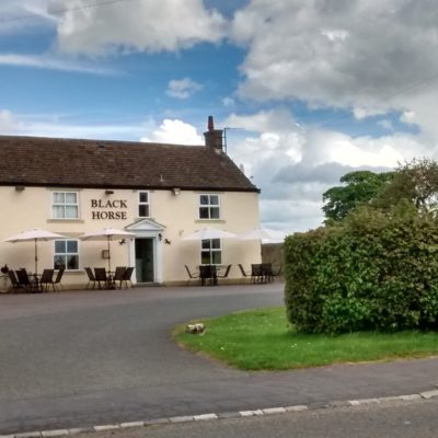 A Front View Of The Black Horse Pub