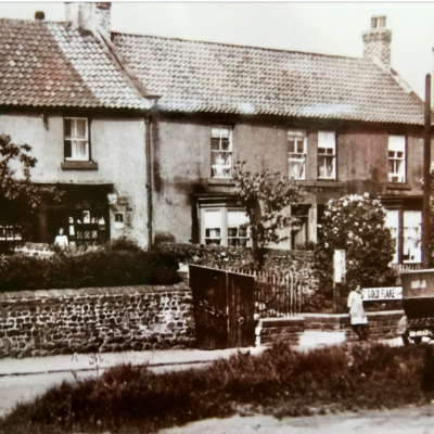 An old view of the old Post Office opposite Rayson House