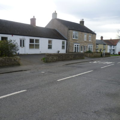 Centre Of Village looking along the cottages on the south side