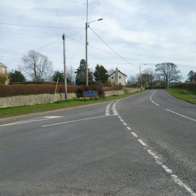 Road junction at the west end of the village looking eastwards